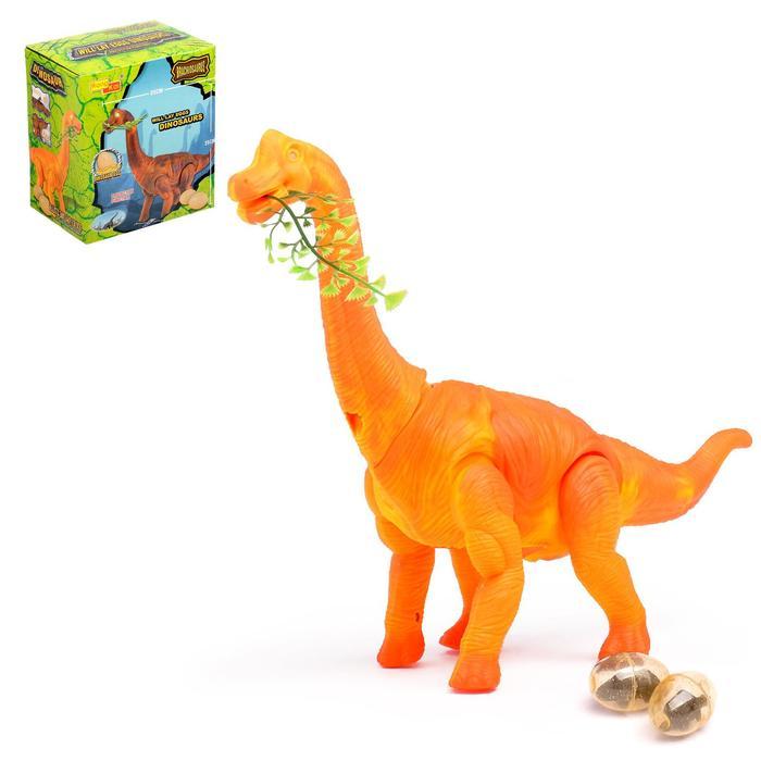 Динозавр «Брахиозавр травоядный», работает от батареек, откладывает яйца, с проектором, цвет оранжевый