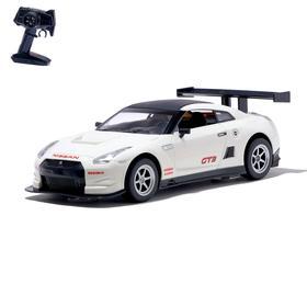 Машина радиоуправляемая Nissan GT-R, масштаб 1:16, работает от аккумулятора, свет, цвет белый